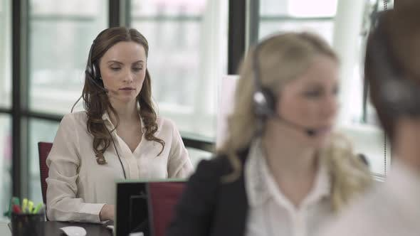 Thumbnail for Caucasian Woman Works In A Attractive Modern Call Center (4 Of 4)