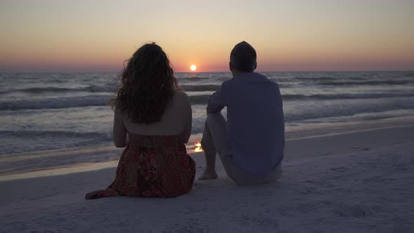 Thumbnail for Couple Relaxing On Beach At Sunset (2 Of 5)
