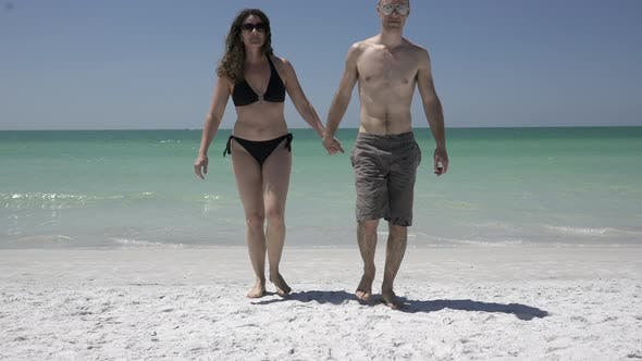 Thumbnail for Couple Walking On A Morning Beach (1 Of 3)