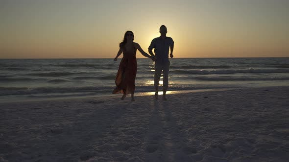 Thumbnail for Couple Walking On Beach At Sunset (12 Of 23)
