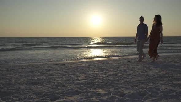Thumbnail for Couple Walking On Beach At Sunset (15 Of 23)