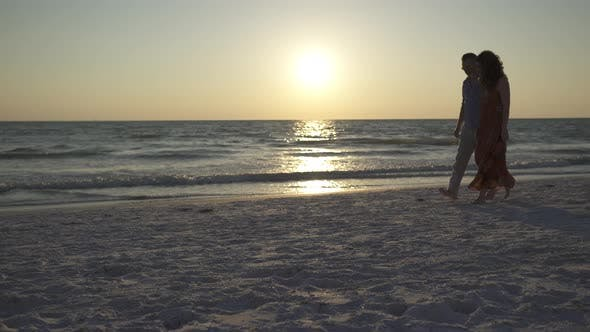 Thumbnail for Couple Walking On Beach At Sunset (6 Of 23)