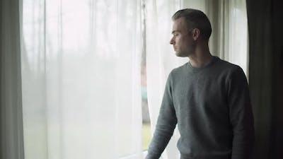 Depressed Man At Window (2 Of 9)