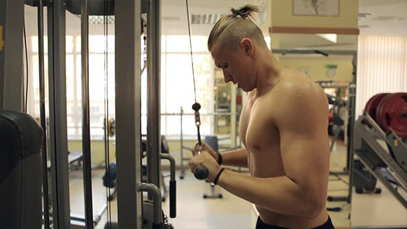 Thumbnail for Men Exercising Triceps In Gym