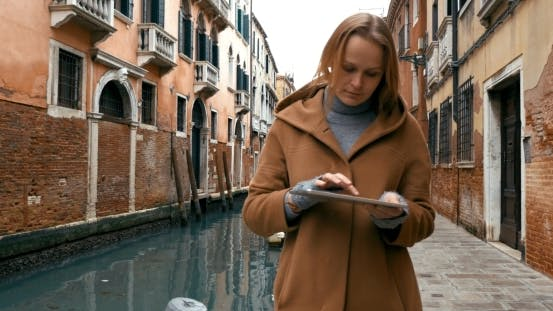 Thumbnail for Woman Wandering In Venice With Pad