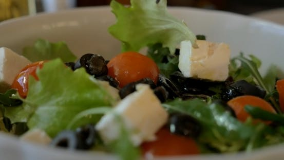 Thumbnail for Tossing Greek Salad Before Eating