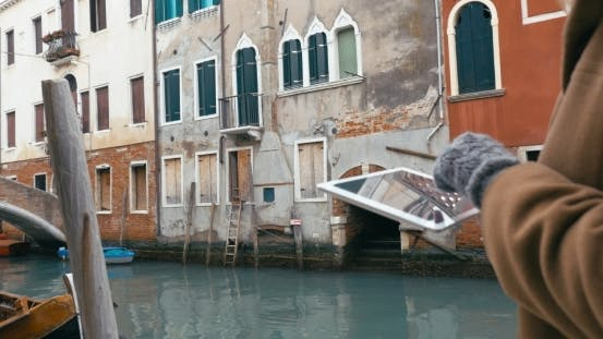 Thumbnail for Girl Using Tablet PC During The Walk In Venice