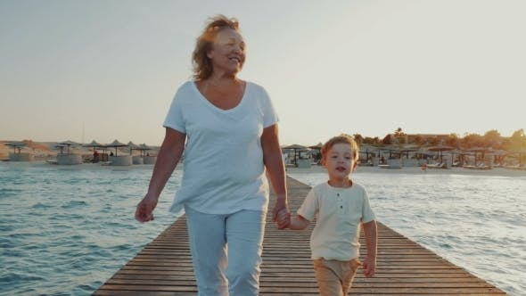 Thumbnail for Grandmother And Grandson Having Outdoor Walk On