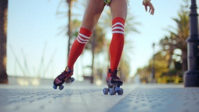 Low Angle Shot Of Roller Skating Girl