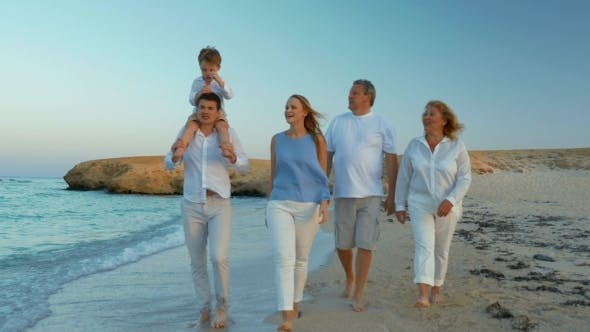 Thumbnail for Big Family Walking By The Sea