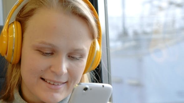 Cover Image for Woman Using Cell And Listening Music In Train