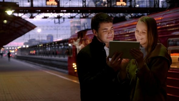 Thumbnail for Man And Woman With Pad At The Station
