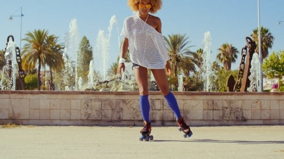 Thumbnail for Beautiful Girl With Afro Haircut On Roller Skates
