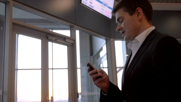 Thumbnail for Businessman Chatting On The Phone At Airport