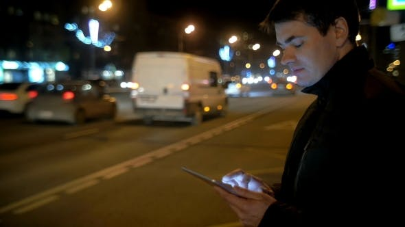 Thumbnail for Man Using Touch Pad By The Busy Road In City