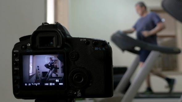 Thumbnail for Camera Making Shots Of Man Running On Treadmill