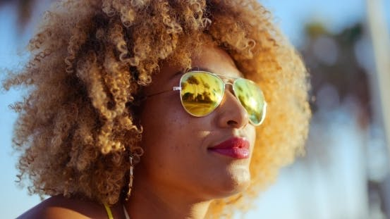 Thumbnail for Close Up Portrait Of Exotic Girl With Afro Haircut