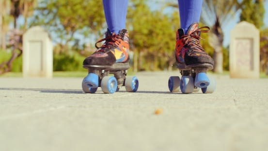 Thumbnail for Low Angle Video Of a Girl Riding Roller Skates