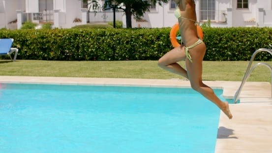 Thumbnail for Happy Girl Jumping Into Swimming Pool