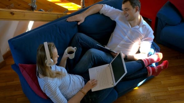 Thumbnail for Young People Relaxing With Music At Home