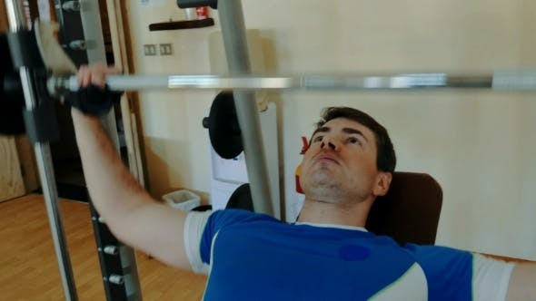 Cover Image for Man Working Out Hard On Chest Press Exercise