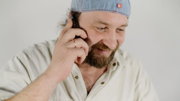 Cover Image for Man Talking on Phone