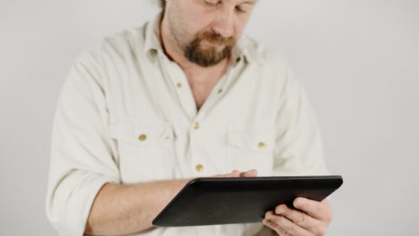 Cover Image for Man with Tablet PC