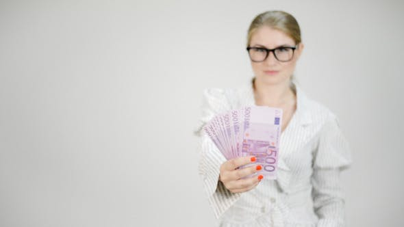 Thumbnail for Money in Successful Businesswoman Hands