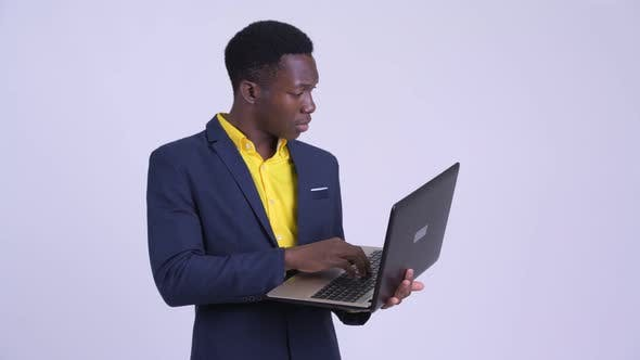 Thumbnail for Young African Businessman Using Laptop and Looking Shocked