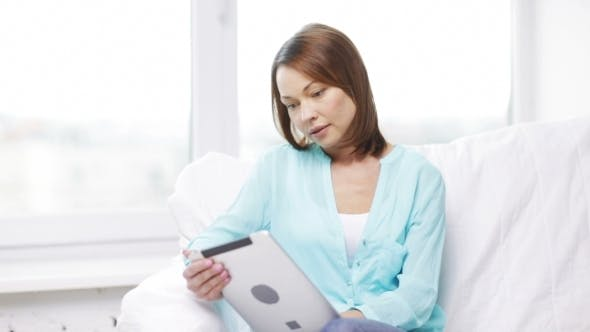 Thumbnail for Woman With Tablet Pc Computer At Home