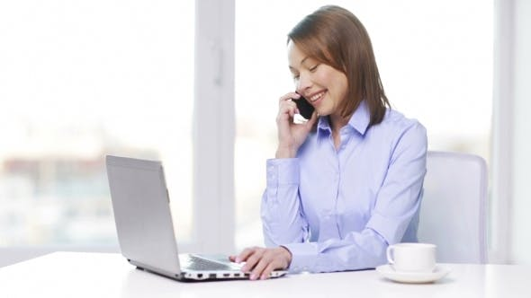 Thumbnail for Businesswoman With Laptop And Smartphone At Office