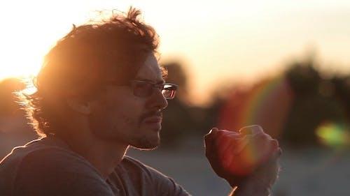 Man Admiring The Sunset