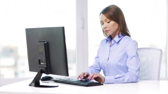 Thumbnail for Businesswoman With Computer In Office