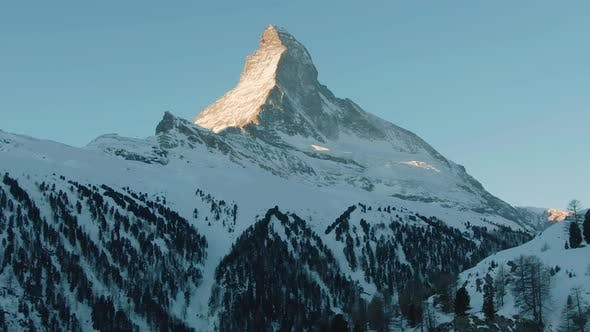 Thumbnail for Matterhorn Mountain in Winter Sunny Morning at Sunrise. Swiss Alps. Switzerland. Aerial View