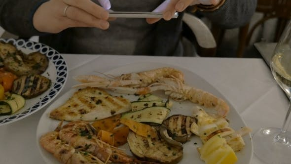 Thumbnail for Woman Taking Photo Of Her Lunch