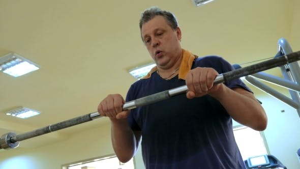 Thumbnail for Man Exercising With Crossbar In The Gym