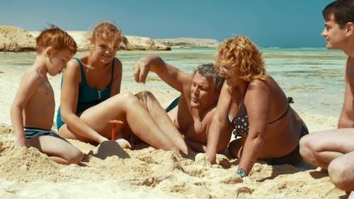 Family Spending Time On The Beach
