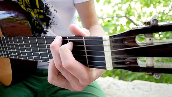 Thumbnail for Young Man Playing A Guitar