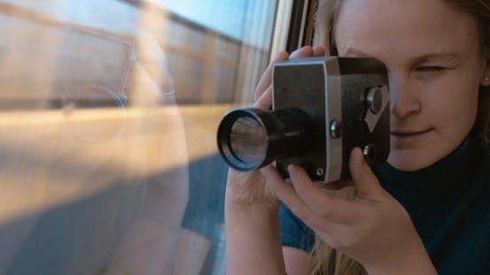 Thumbnail for Woman Using Retro Video Camera To Shoot The Way