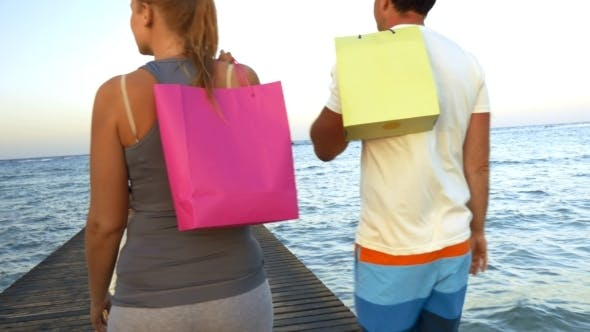 Thumbnail for Family With Shopping Bags Walking On The Pier