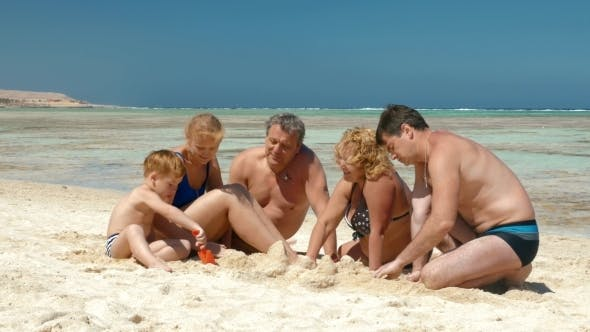 Thumbnail for Big Family Building Sand Castle Together