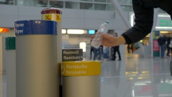 Thumbnail for Man Throwing Plastic Water Bottle In Recycle Bin