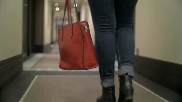 Cover Image for Woman With Bag Walking In Hotel Hall