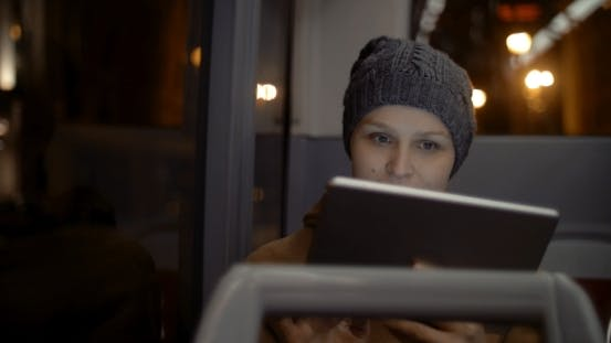 Thumbnail for Woman In The Bus Using Tablet Computer