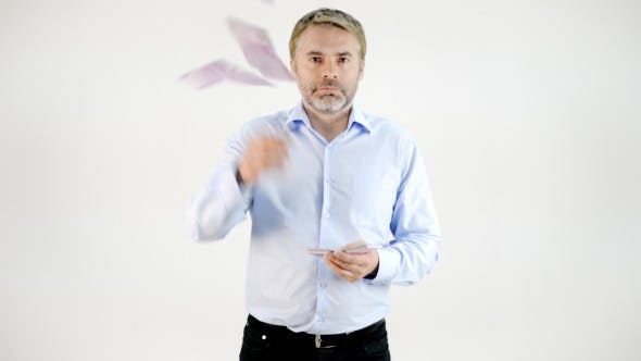 Thumbnail for Middle Aged Businessman Throwing Money