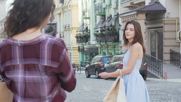 Thumbnail for Woman Posing Gracefully While Her Friend Taking Photos Using Smart Phone