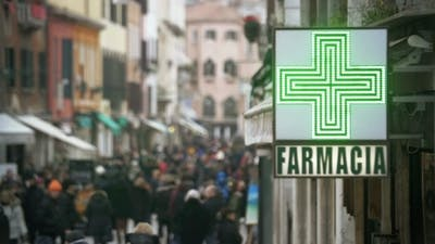 Pharmacy Sign Hanging In Crowded Street