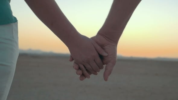 Thumbnail for Loving Couple Holding Hands At Sunset