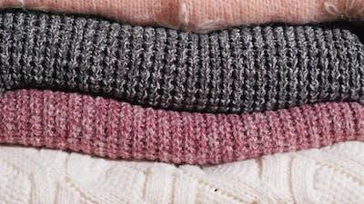 Tilt Shot: Neatly Folded Winter Clothes