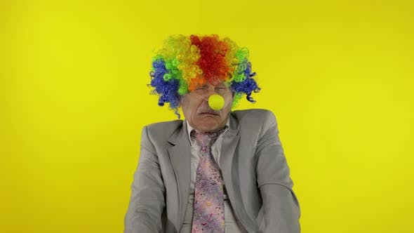 Thumbnail for Elderly Clown Businessman Entrepreneur Boss Making Silly Faces. Copy Space